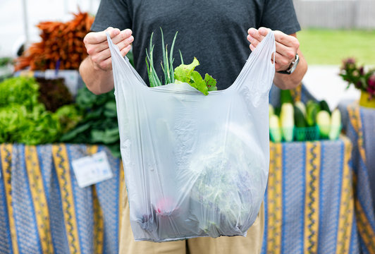 Market: Man Holds Bag Of Purchased Produce