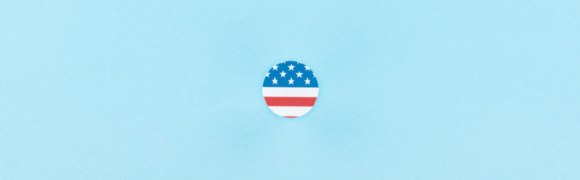 top view of paper cut decorative circle made of american flag on blue background, panoramic shot