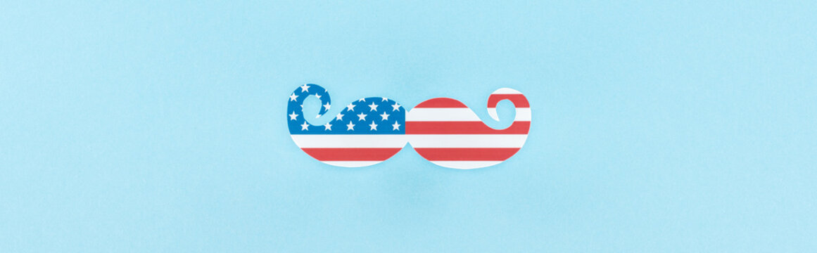 top view of decorative mustache made of american flag on blue background, panoramic shot