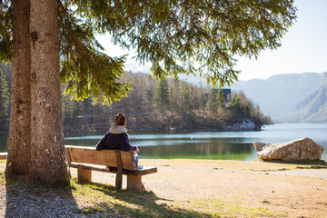 Woman sitting on a bench in a beautiful nature park.