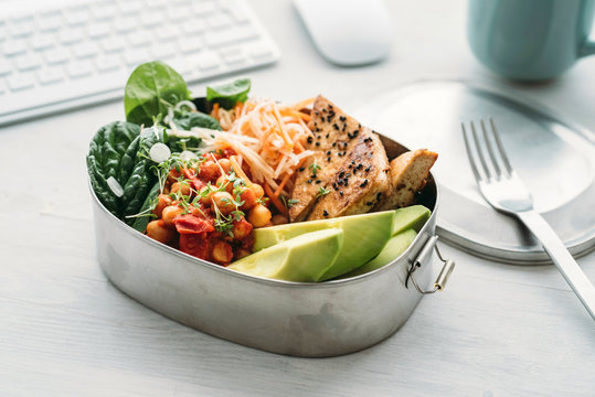 Food: Lunch box salad with chick peas, spinach, avocado, tofu