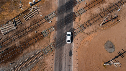 aerial view of a brand new car crossing railway