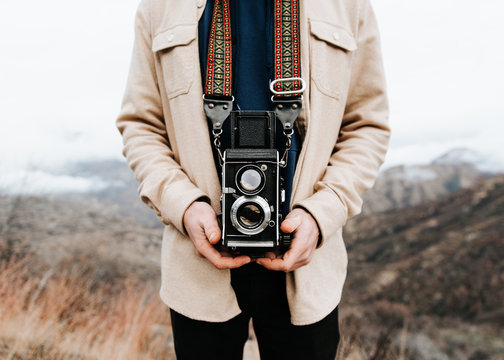 Person holding old camera