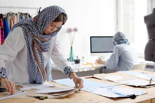 Women working in modern tailor shop
