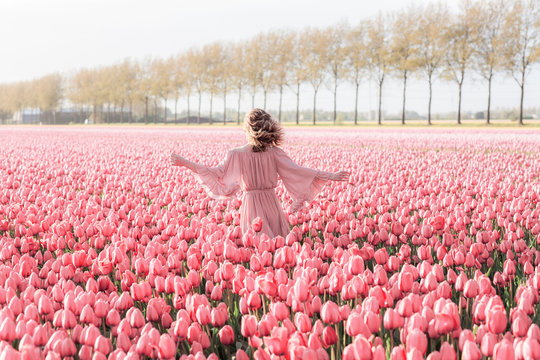 Young woman in a tulip field