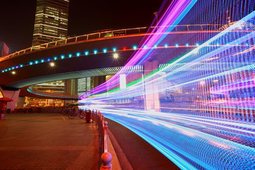 The highway car rainbow light trails of modern city buildings Fotomurales