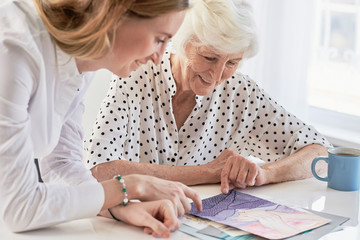 Woman Showing Painting To Grandma