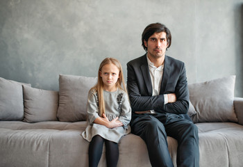 Father and daughter both annoyed and unhappy