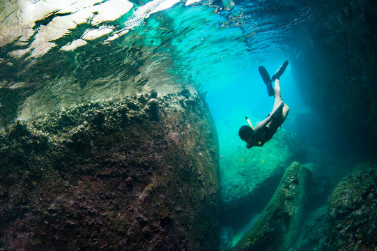 Female Diver with Reflection, Swimming in Cavern (Various Compositions)