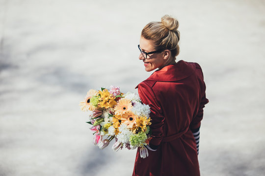 Pretty Woman Carrying a Bouquet