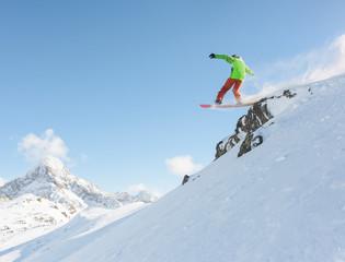 Snowboarder making a drop