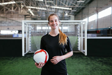 Female soccer player in indoor football.