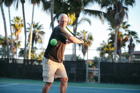 Middle age man playing tennis