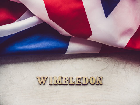 WIMBLEDON. Wooden, unpainted letters on a white table. Close-up, top view. Beautiful photo for invitation card