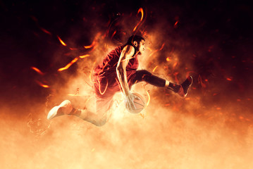 Man basketball player on flames background
