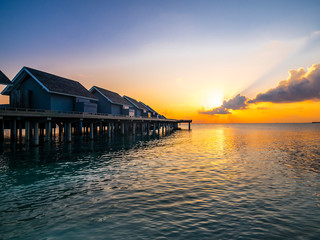 Maledives, Ross Atoll, water bungalows at sunset