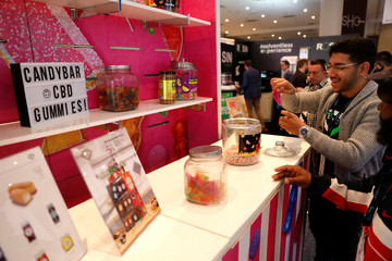 An attendee takes samples of CBD candies at The Cannabis World Congress & Business Exposition (CWCBExpo) trade show in New York