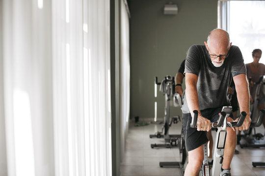 Man riding spin bike