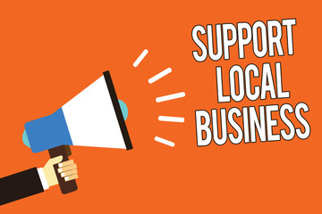 Writing note showing Support Local Business. Business photo showcasing increase investment in your country or town Man holding megaphone loudspeaker orange background message speaking
