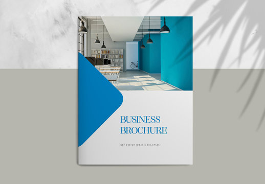 Blue Brochure Layout with Graphic Diamond Accents