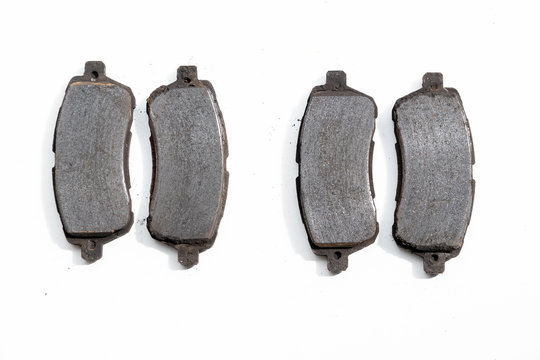 Worn out old rusty brake pads