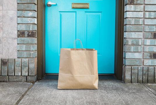 shopping bag in front of apartment door