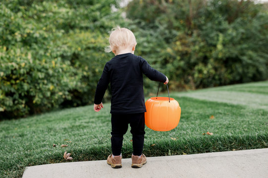 behind a toddler on Halloween