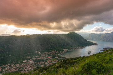 Foto auf Gartenposter Gebirge Bay of Kotor from the heights. View from Mount Lovcen to the bay. View down from the observation platform on the mountain Lovcen. Mountains and bay in Montenegro. The liner near the old town of Kotor.