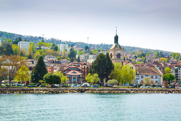 Shore of Lake Geneva in Evian-les-Bains city in France