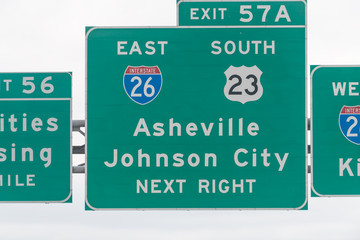Asheville and Johnson City exit sign on highway in Tennessee on interstate 81 closeup of text