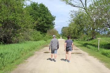 Foto op Aluminium Afrika Middle-aged man and woman walking on Twin Oaks Trail at Midewin National Tallgrass Prairie