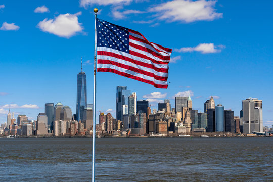 Scene of Flag of America over New york cityscape river side which location is lower manhattan,Architecture and building with tourist and Independence day concept