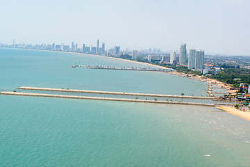 Pattaya City in Thailand has buildings located along the beach and sea.