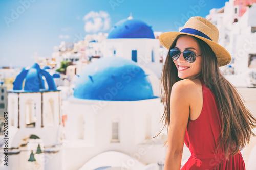 Wall mural Travel Europe summer holiday girl enjoying Oia, Santorini Greece cruise vacation. Sun getaway Asian woman smiling in hat and sunglasses.