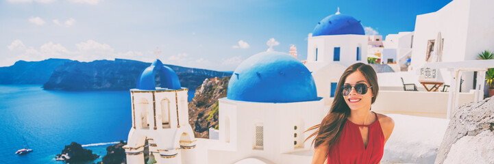 Fototapete - Europe summer vacation tourist woman walking in Oia city at three blue domes church, Santorini, Greece. Popular european attraction famous cruise travel. Banner panorama.