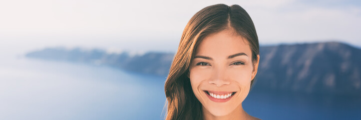 Wall Mural - Young happy woman, Asian beauty model smiling outside in sun. Portrait of chinese caucasian girl in her 20s, beautiful multiracial young female, banner panorama.