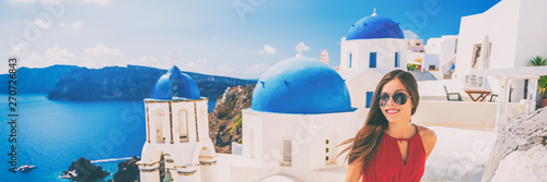 Wall mural Europe summer vacation tourist woman walking in Oia city at three blue domes church, Santorini, Greece. Popular european attraction famous cruise travel. Banner panorama.