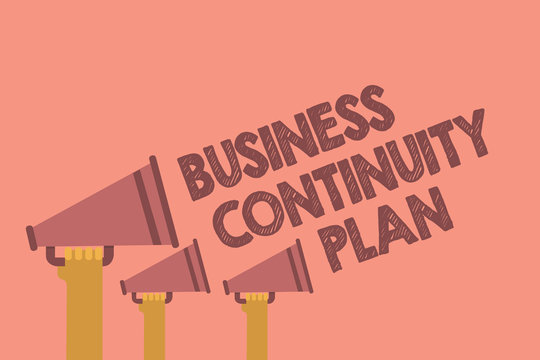 Writing note showing Business Continuity Plan. Business photo showcasing creating systems prevention deal potential threats Hands holding megaphones loudspeaker important message pink background