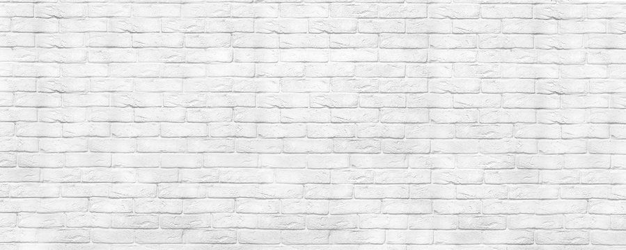 White brick wall texture panoramic backdrop. Home and office washed design background. Painted bricks wall