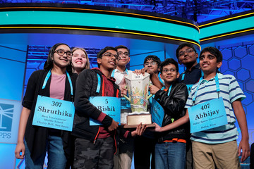 Champions in an eight-way tie celebrate after the final round of the 92nd annual Scripps National Spelling Bee in Oxon Hill, Maryland.
