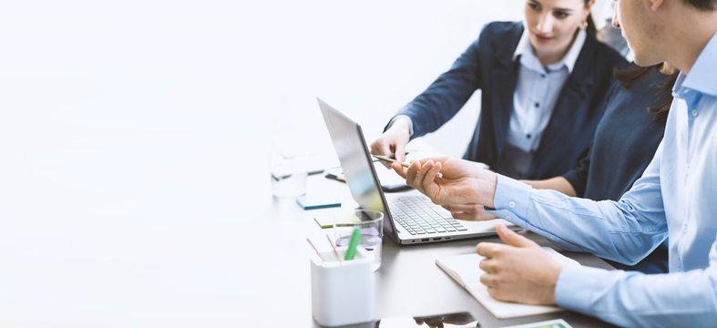 Professional business team working together at desk