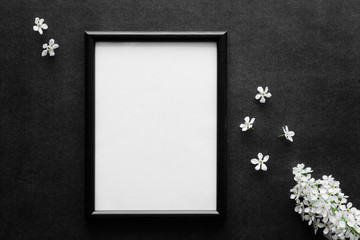 Fresh white bird cherry on black, dark background. Condolence card. Empty place for emotional, sentimental text, quote, sayings or photo in frame.