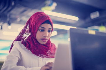 black muslim business woman ,working on laptop computer