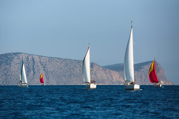 Wall Mural - Sailing yacht boats in regatta at the Aegean Sea - Greece.