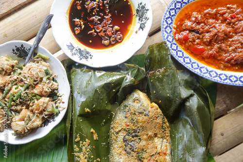 Traditional Indonesian cuisine  Grilled fish with spices served on