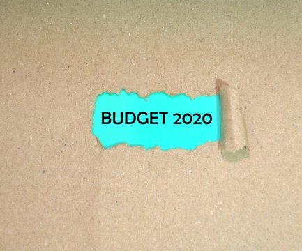 BUDGET 2020 word on torn paper background.