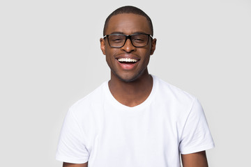 Headshot portrait african man in glasses laughing looking at camera