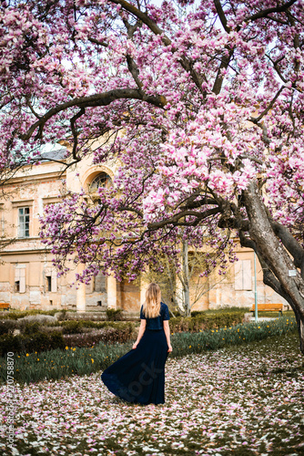 Outdoor Photo Of Young Woman Standing Posing Under Magnolia Tree In