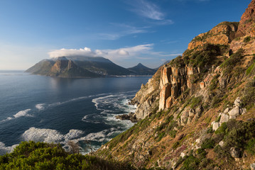 Rocky cliffs on the coastline of the Atlantic Ocean near Cape Town on Chapman's Peak Drive, South Africa