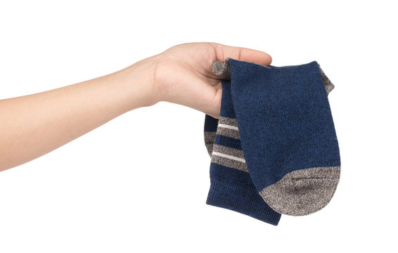 hand holding sport socks isolated on a white background